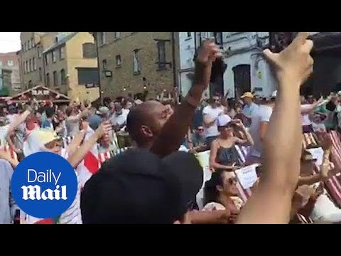 England fans cheers as Maguire opens the...