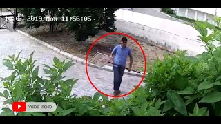 CCTV FOOTAGE  | Angry Resident hurls the dog poop board.
