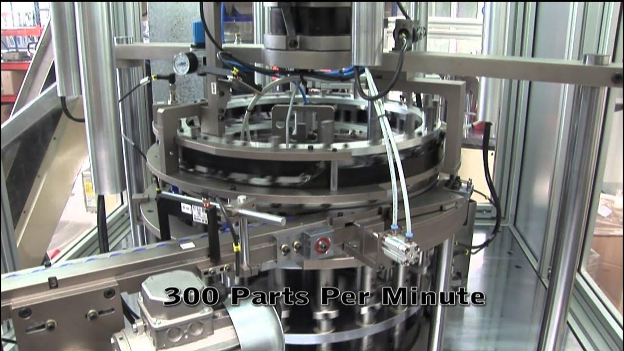 Maquina ensambladora de movimiento continuo / Assembly continuous ...