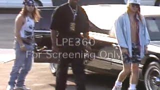 axl rose guns n roses exiting limo with bodyguards and sword