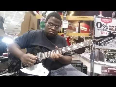 Playing a 2018 Gibson Firebird V at Sam Ash Musical instruments in Richmond, Virginia