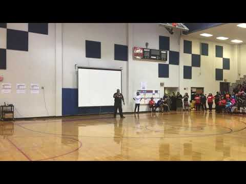 Alpha Math Teacher steps for Black History Month Celebration at Columbia Middle School