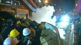 Innovative Hong Kong protesters use lasers, traffic cones and street signs in battle with police