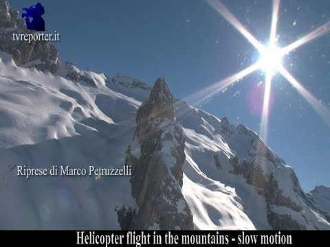 Helicopter flight in the mountains, slow motion The Dolomites Mountains -Italy
