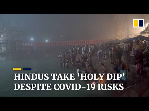 Hindu pilgrims brave Covid-19 risks to take 'holy dip' in India's Ganges River