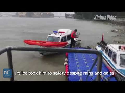 Police rescue kayaker stranded by Typhoon Maria in E China