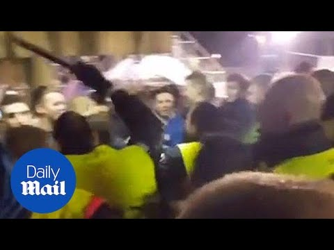 Nou Camp security guards baton-charge Chelsea fans leaving stadium - Daily Mail