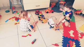 Funny babies playing together