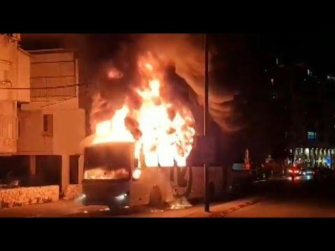 Israeli Haredis Torch Bus Amid Heightened Lockdown Tensions | AFP