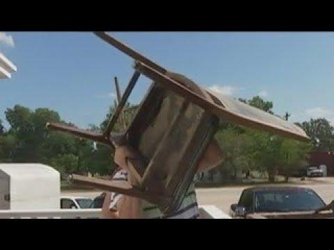 KTBC - People in La Grange clean up after historic flood