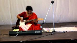 Lakshmi playing South Indian Carnatic music on Guitar and Keyboard