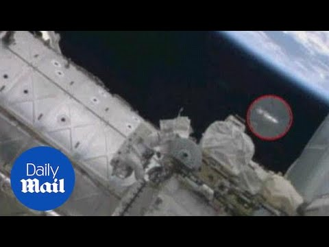 UFO spotted above astronaut as he repairs ISS - Daily Mail