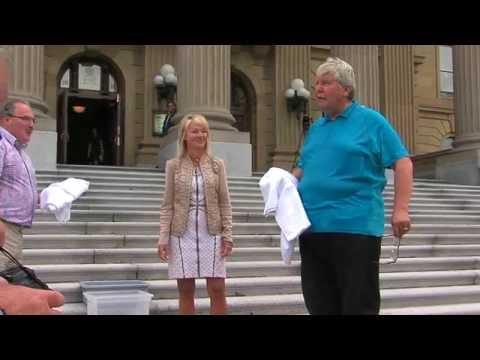 Premier Hancock accepts the ALS Ice Bucket Challenge