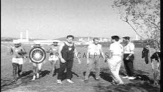 Athletes work out on exercise field during Summer Olympics of 1960 in Rome, Italy...HD Stock Footage