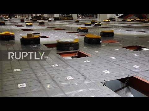 China: They're coming for our jobs! Army of robots sorts 200,000 parcels a day - w/o a coffee break