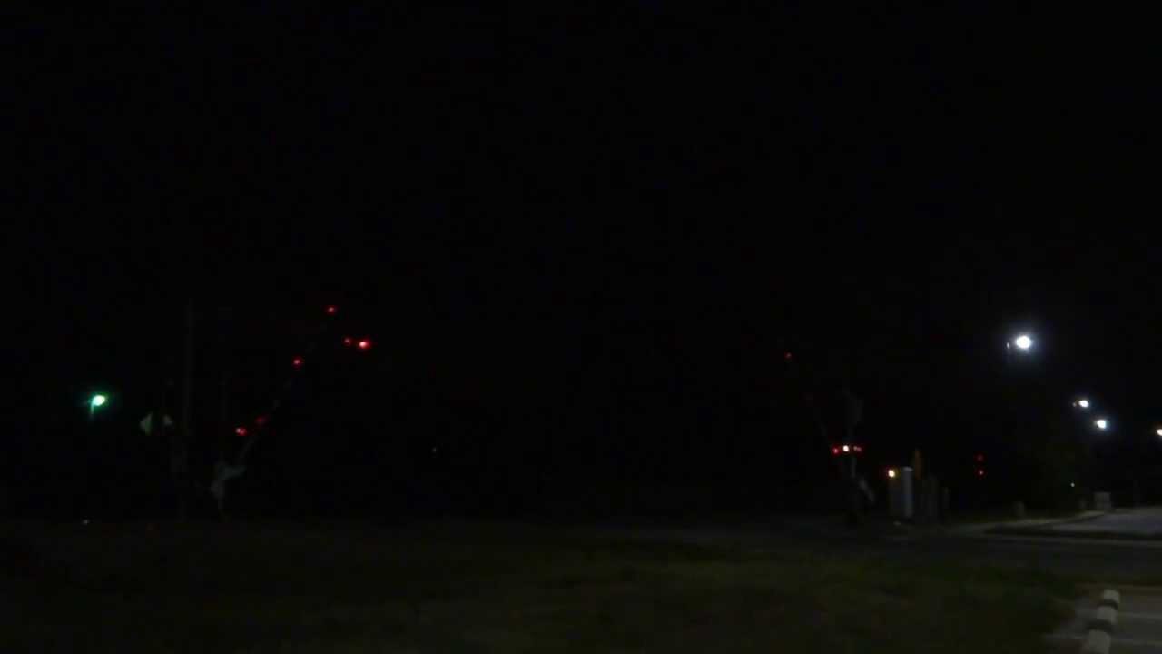 CSX: mixed freight train @ a railroad crossing at night / Woodruff SC