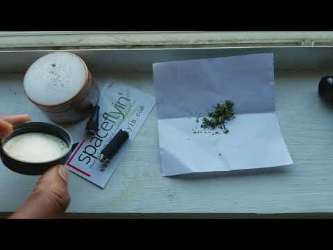 Loading G Pen dry herb vaporizer cartridge.