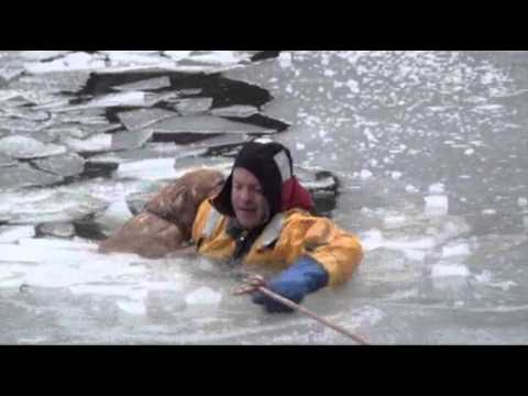 Raw: Firefighters Rescue Family Dog in Icy River