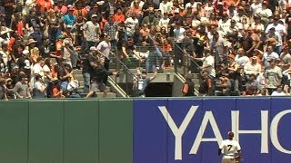 COL@SF: Tulo launches two-run homer, fan catches ball