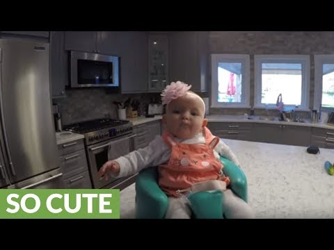 Baby enjoys ride atop robot vacuum cleaner