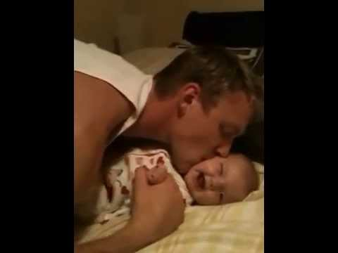 Daddy tickles baby
