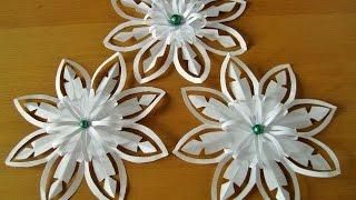 Schneeflöcken mit Kerzen aus Papier selber machen