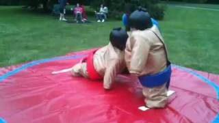 Little kids in sumo suits
