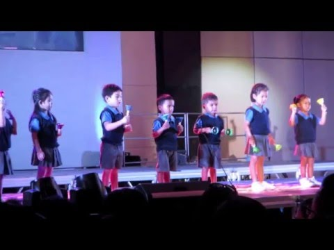 Pre-k children at Singapore School Cebu making music using bells