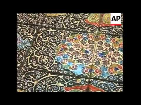 Iranian master tilers make traditional blue tiles for Islamic architecture