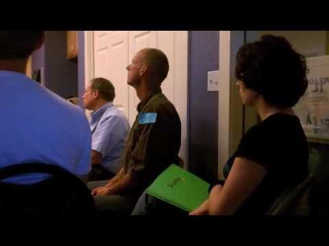 Co-op workers mic check board meeting
