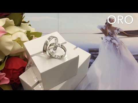 Обручальные кольца из белого золота с потайным бриллиантом