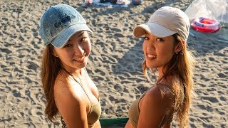 Gambar cover Booze and babes on Enoshima beach.