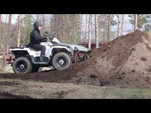 Latvo´s hydraulic plow bucket with Polaris ATV