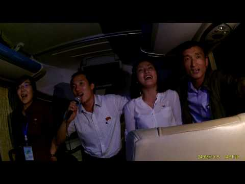 North Korean tour guides sing their national anthem