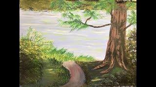 Pintando paisaje con árbol frente al río