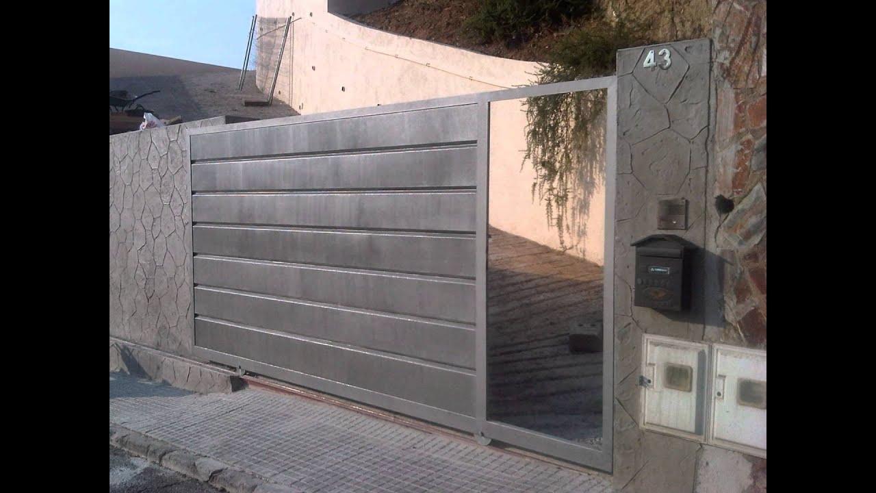 Puerta de garaje corredera en barcelona por norestim youtube for Puerta garaje metalica