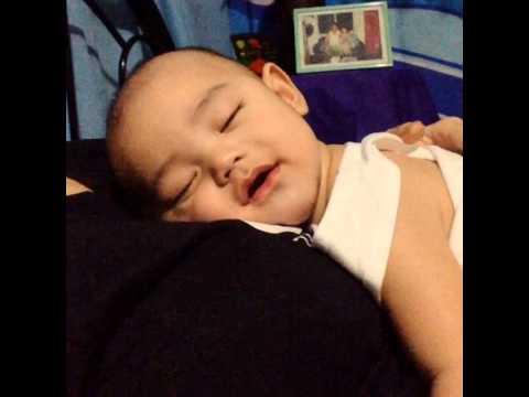 Baby Smiling While Sleeping