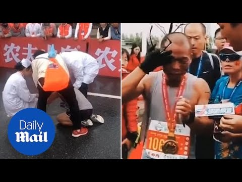 Dad bursts in tears as he finishes marathon holding dead son's pic