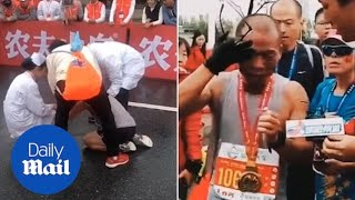 Dad bursts in tears as he finishes marathon holding dead son