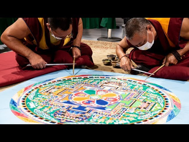 Tibetan Buddhist monks sand painting a mandala