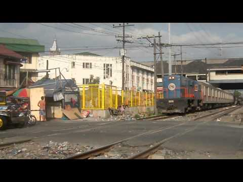 PNR Commuter train passing crossong