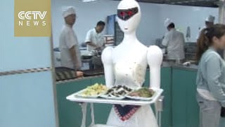 Cute robot waiter takes over restaurant in China