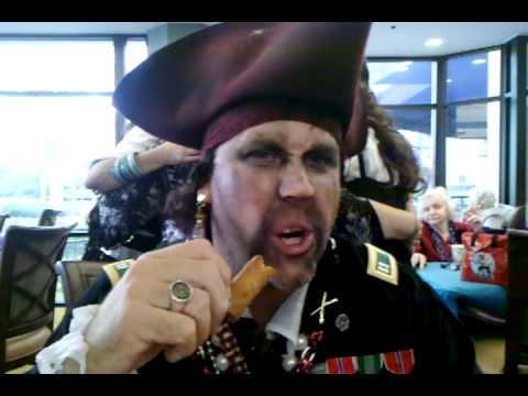 Gasparilla 2012 - A Pirate eating with Fake Teeth!