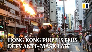Hong Kong protesters defy anti-mask law