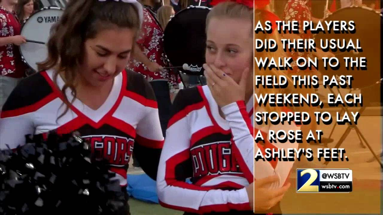 football players support cheerleader recently diagnosed with