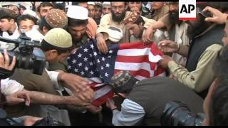 Pro-Taliban protesters burn US flags to condemn bin Laden