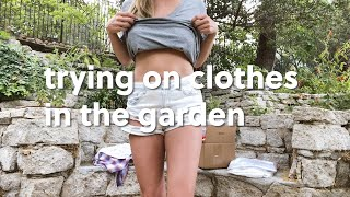 Trying On New Clothes In The Garden.