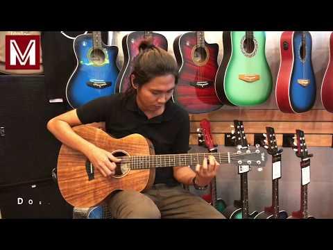 Cyrus on guitar