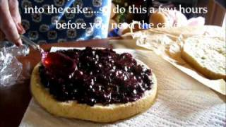 Putting Berry Jam On The Cake Layers