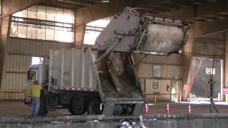 Garbage Trucks Unloading